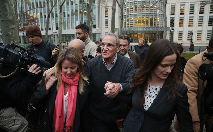 Alleged Bonanno crime family captain Vincent Asaro walks with his lawyers outside of a Brooklyn court house after a jury found him not guilty. He was charged in connection with the 1978 Lufthansa heist at JFK Airport. The crime inspired the 1990 mob film Goodfellas. Picture: AFP.