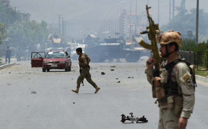 FILE: Afghan security personnel take position at the site of an attack in area of the attack in Kabul. Picture: AFP.