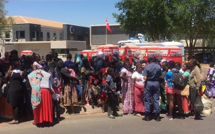 Refugees and foreign nationals outside the UN Refugee Agency building in Brooklyn, Pretoria where they have been removed from the area by police on 15 November 2019. Picture: Kgomotso Modise/EWN