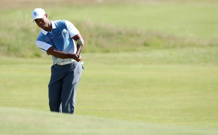 US golfer Tiger Woods chips onto the 5th green during his first round on the opening day of the 2014 British Open Golf Championship at Royal Liverpool Golf Course in Hoylake, north west England on July 17, 2014. Picture: AFP