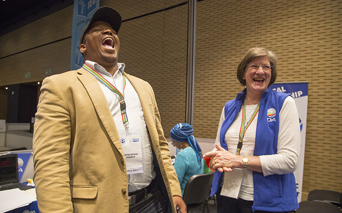 ANC mayoral candidate in Cape Town, Xolani Sotashe, jokes with Alderman Anthea Serritslev of the DA at the IEC's provincial results centre on 3 August 2016. Picture: Aletta Harrison/EWN