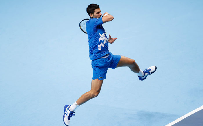 Novak Djokovic puts some effort into a return at the ATP Finals. Picture: @atptour/Twitter