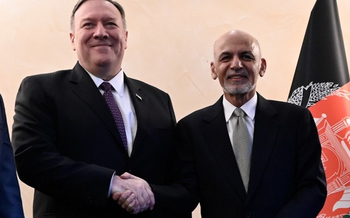In this file photo taken on 14 February 2020 US Secretary of State Mike Pompeo (L) shakes hands with Afghan President Ashraf Ghani (R) during the 56th Munich Security Conference (MSC) in Munich, southern Germany. Picture: AFP