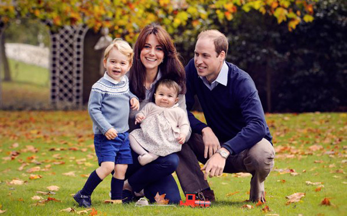 Prince William and the Duchess of Cambridge with their two children, Charlotte and George, pose for their first Christmas card as a family. Picture: @KensingtonRoyal.