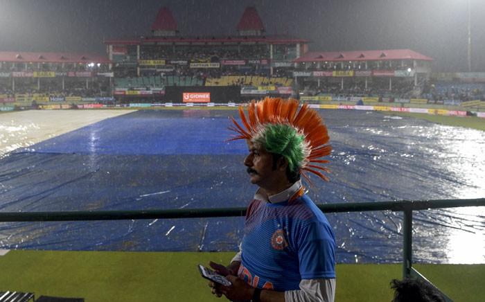 FILE: A cricket fan looks on as he stands on the grandstand before the start of the first Twenty20 international cricket match of a three-match series between India and South Africa at Himachal Pradesh Cricket Association Stadium in Dharamsala on 15 September 2019. Picture: AFP