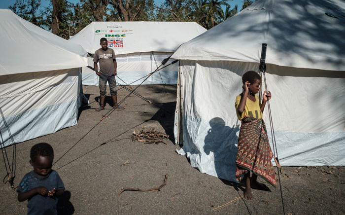 People stay at an evacuation site after losing their homes after the passage of Cyclone Idai in Tica, Mozambique, on 24 March 2019. Picture: AFP