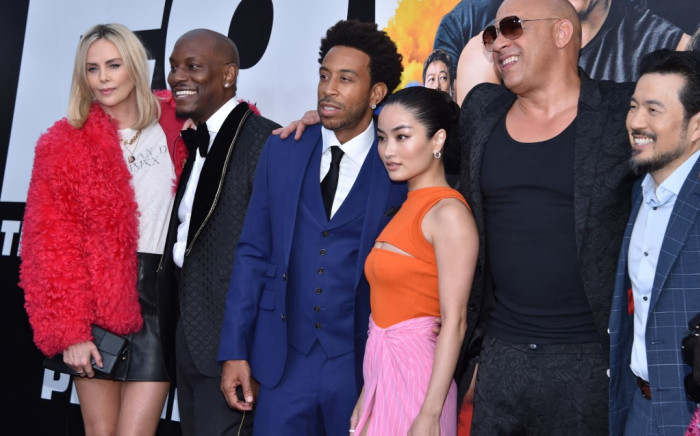 """South African-US actress Charlize Theron, actor Tyrese Gibson, actor-musician Chris """"Ludacris"""" Bridges, Japanese-New Zealand actress Anna Sawai, actor-producer Vin Diesel and US-Taiwanese director Justin Lin arrive for the world premiere of """"F9: The Fast Saga"""" at the TCL Chinese theatre in Hollywood on June 18, 2021. Picture: AFP."""
