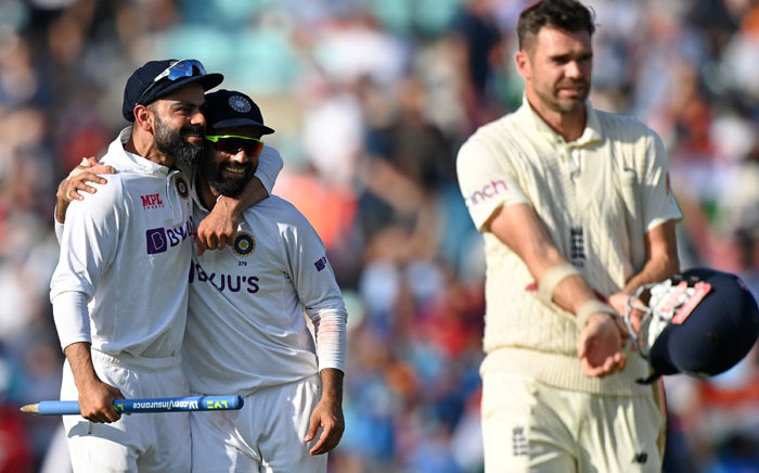 India's captain Virat Kohli (L) celebrates after England's James Anderson (R) lost his wicket during play on the fifth day of the fourth cricket Test match between England and India at the Oval cricket ground in London on 6 September 2021. Picture: Glyn Kirk/AFP