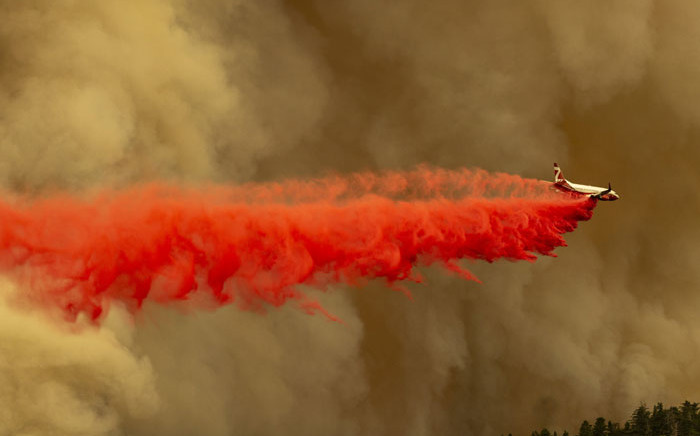 A Coulson 737 firefighting tanker jet drops fire retardant to slow Bobcat Fire at the top of a major run up a mountainside in the Angeles National Forest on 10 September 2020 north of Monrovia, California. Picture: AFP