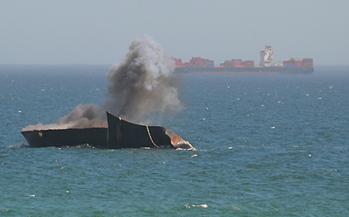 FILE: A charge is used on the bow of the Seli 1 wreck at Bloubergstrand in Cape Town on 13 March 2013 with the aim of splitting and eventually sinking the remnants of the vessel. Picture: Aletta Gardner/EWN