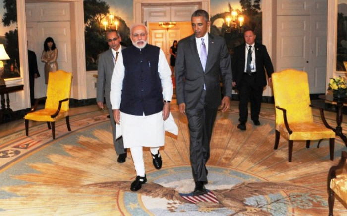 Indian Prime Minister Narendra Modi (centre L) walks with US President Barack Obama at the White House in Washington, DC, on 29 September, 2014. Picture: AFP.