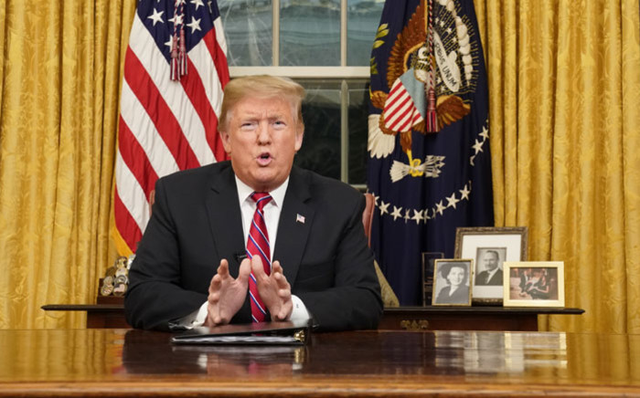 US President Donald Trump delivers a televised address to the nation on funding for a border wall from the Oval Office of the White House in Washington DC on 8 January 2019. Picture: AFP