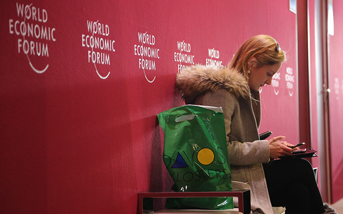 FILE: A woman sits on a bench in the registration hall of the 2016 World Economic Forum in Davos, Switzerland. Picture: Reinart Toerien/EWN