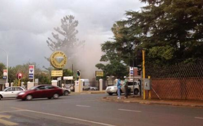 Smoke rises from Radovan Krejcir's Moneypoint shop in Bedfordview shortly after an explosion on 12 November 2013. Picture: @mickey_gp/Twitter.