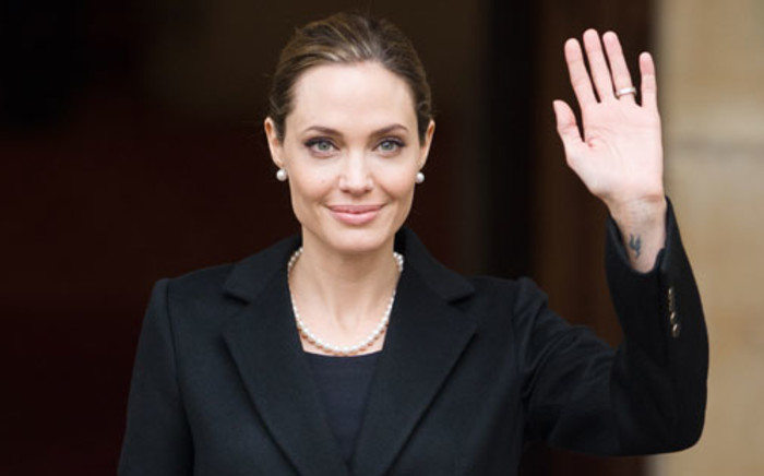 FILE: Angelina Jolie and British Foreign Secretary William Hague vowed to take action on ending sexual violence. Picture: AFP.