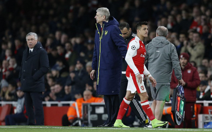 FILE: Arsenal's striker Alexis Sanchez walks past manager Arsene Wenger after being substituted in a match. Picture: AFP