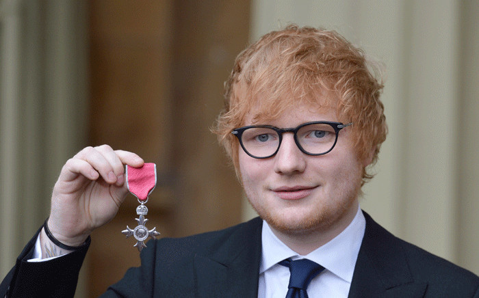 British singer-songwriter Ed Sheeran poses with his medal after being appointed a Member of the Order of the British Empire (MBE) for services to music and charity during an Investiture ceremony at Buckingham Palace in London on 7 December 2017. Picture: Pool/AFP.