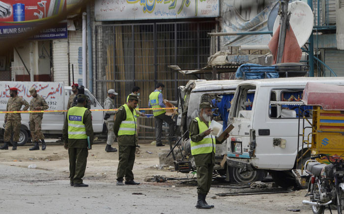 Pakistani security officials inspect the scene of a bomb attack in Lahore on 5 April 2017. At least five people were killed and up to 18 wounded in a suicide blast claimed by the Taliban which targeted a census team in Pakistan's eastern city of Lahore. Picture: AFP
