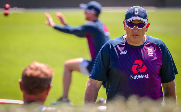 England's head coach Chris Silverwood (R) walks across the ground during a team training session ahead of the second cricket Test between England and New Zealand at Seddon Park in Hamilton, on 27 November 2019. Picture: AFP