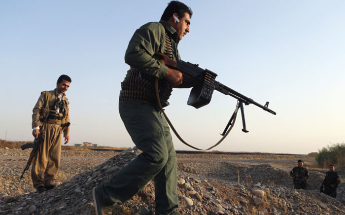 FILE:Iraqi Kurdish Peshmerga fighters patrol the town of Gwer which remains on the frontline of fighting between Kurdish forces and militants from Islamic State (IS), 40Km south of Erbil, Iraq, 18 September 2014. Picture: EPA.