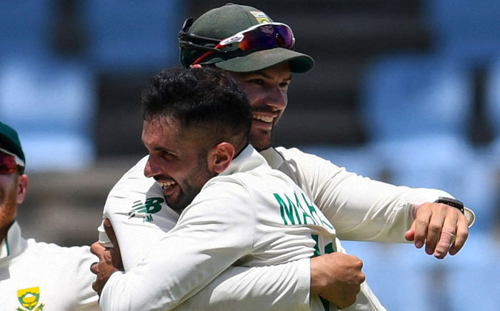 Keshav Maharaj (right) hugs teammate Aiden Markram after taking a hat-trick of wickets against the West Indies in the second Test on 21 June 2021. Picture: @OfficialCSA/Twitter