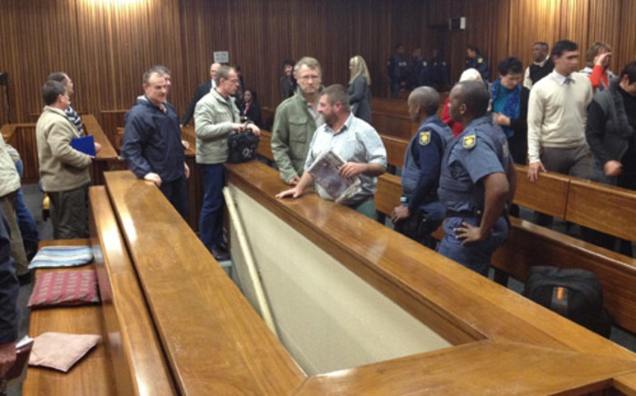 Some of the Boeremag accused being led to the holding cells in the North Gauteng High court. Picture: Barry Bateman/EWN
