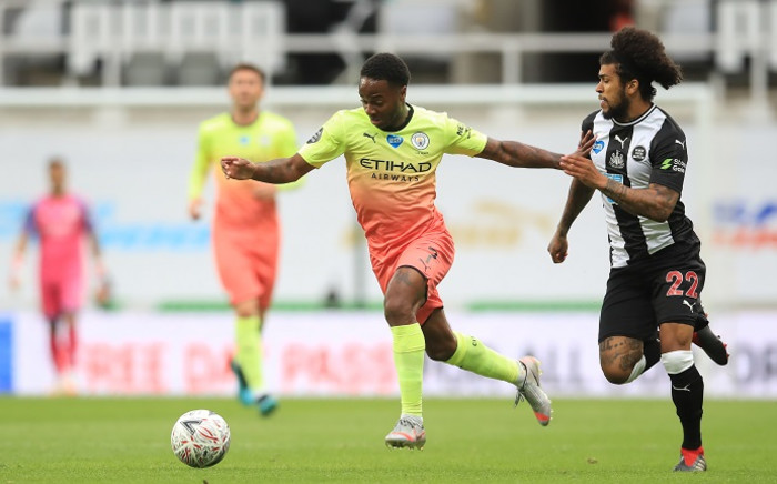 Manchester City's English midfielder Raheem Sterling (L) runs away from Newcastle United's US defender DeAndre Yedlin (R) during the English FA Cup quarter-final football match between Newcastle United and Manchester City at St James' Park in Newcastle-upon-Tyne, north east England on 28 June 2020. Picture: AFP