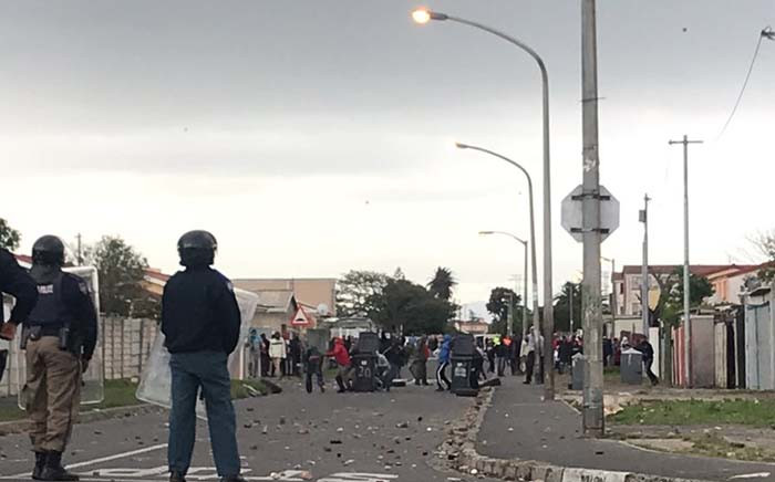 Parkwood residents battled with law enforcement officials who broke down their structures on 23 May 2018. Picture: Kaylynn Palm/EWN