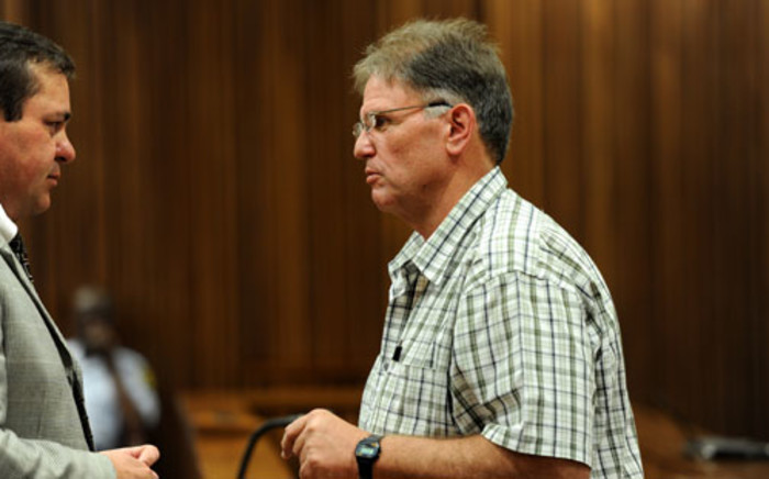 "FILE: Johan Kotze (R), also known as the ""Modimolle monster"", is seen in the dock in the North Gauteng High Court on Wednesday, 21 November 2012. Picture: Werner Beukes/SAPA."