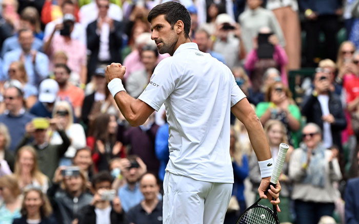 Serbia's Novak Djokovic celebrates his victory over South Africa's Kevin Anderson during their men's singles second round match on the third day of the 2021 Wimbledon Championships at The All England Tennis Club in Wimbledon, southwest London, on 30 June 2021. Picture: Ben STANSALL/AFP