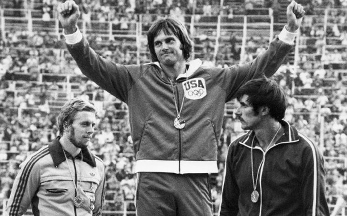 A file picture taken on 30 July, 1976 in Montreal, shows USAs Bruce Jenner (C) celebrating his gold medal on the podium after winning the mens decathlon competition, next to West German silver medalist Guido Kratschmer (L) and USSRs bronze medalist Nikolay Avilov. Picture: AFP.