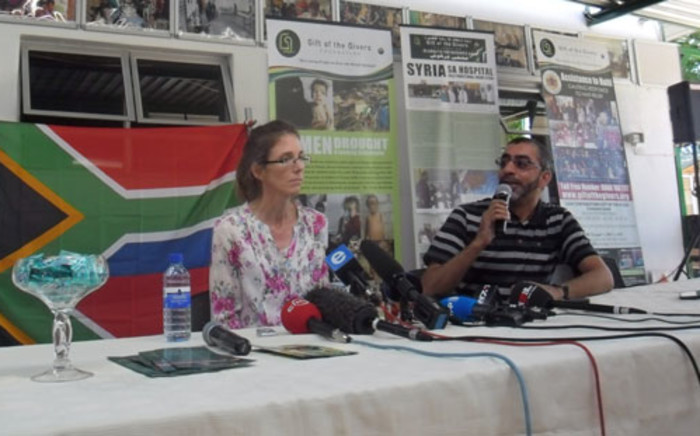 Yolande Korkie with Gift of the Givers' Dr Imtiaz Sooliman during a press conference in Johannesburg on 16 January 2014. Picture: Govan Whittles/EWN