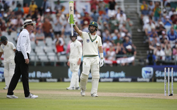 South Africa's Pieter Malan (R) celebrates after scoring a half-century (50 runs) as umpire Paul Reiffel (L) looks on during the fourth day of the second Test cricket match between South Africa and England at the Newlands stadium in Cape Town on 6 January 2020. Picture: AFP