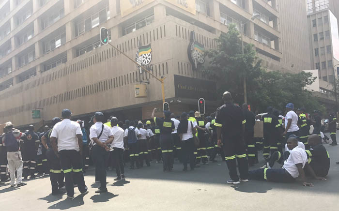 Emergency services workers gathering outside the Luthuli House in Johannesburg. Picture: Masego Rahlaga/EWN
