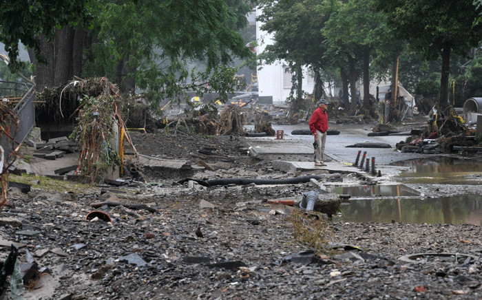 An elderly man stands amidst the rubble in a devastated street after the floods caused major damage in Bad Neuenahr-Ahrweiler, western Germany, on July 16, 2021. Picture: Christof Stache / AFP.