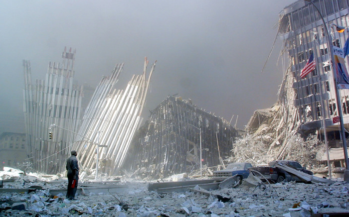 In this file photo taken on 11 September 2001, a man stands in the rubble after the collapse of the first World Trade Center Tower in New York. Picture: AFP.