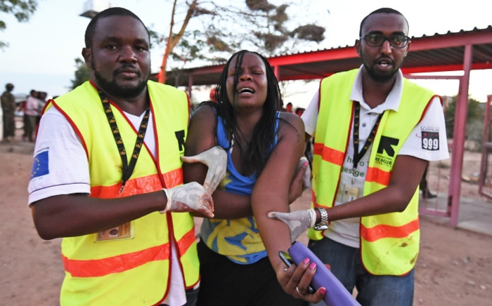 FILE: Paramedics help a student who was injured during an attack by al-Shabaab gunmen on the Garissa University College campus in Kenya on April 2, 2015. Picture: AFP.