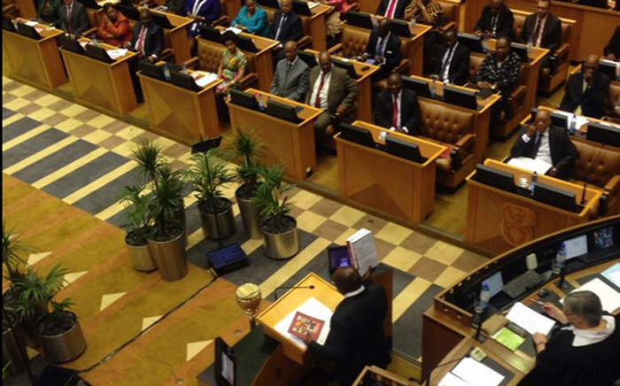 Finance Minister Nhlanhla Nene tables his budget, hold it's up in the air as he concludes his speech. Picture: Rahima Essop/EWN.