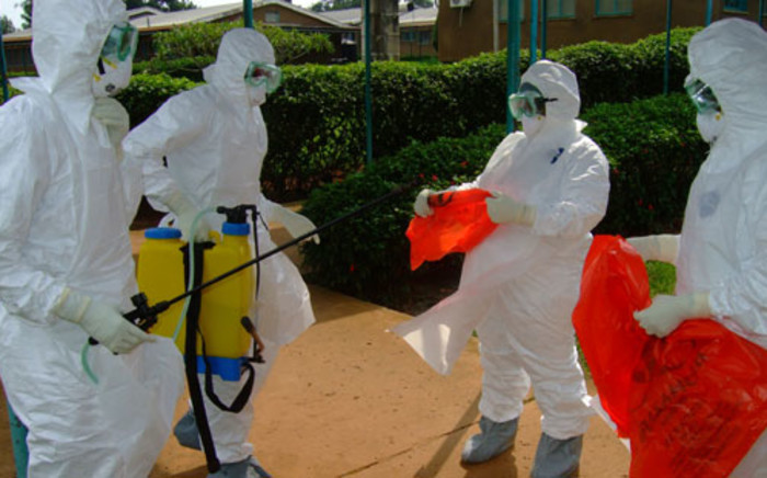 FILE: Officials from the World Health Organisation wear protective clothing as they prepare to enter Kagadi Hospital in Kibale District, where an outbreak of Ebola virus started. Picture: AFP.