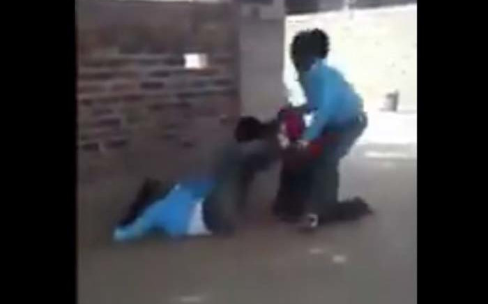 The video of two schoolgirls in uniform attacking a peer in civvies has been widely shared on social media. Picture: Twitter screengrab
