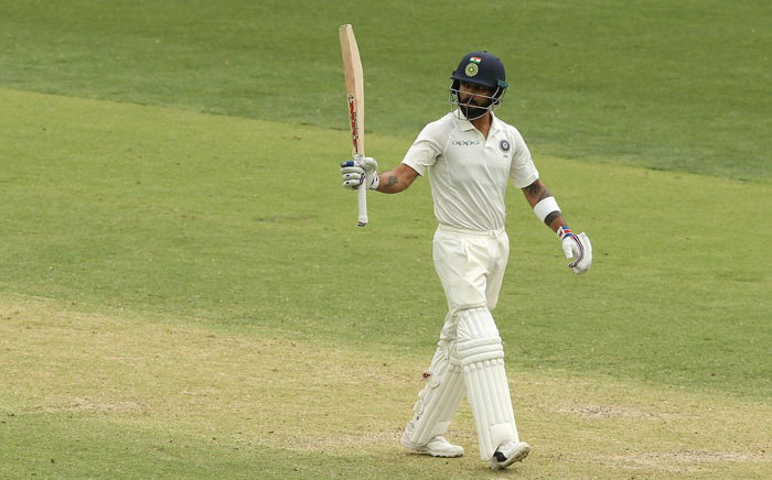 FILE: India's Virat Kohli raises his bat after scoring a half-century on day 2 of the second Test against Australia in Perth on 15 December 2018. Picture: @BCCI/Twitter