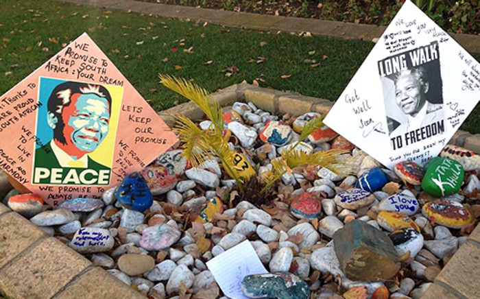 A Johannesburg family created two artworks to send messages of support for former president Nelson Mandela. They placed it outside his Houghton home on 9 June, 2013. Picture: Lesego Ngobeni/EWN