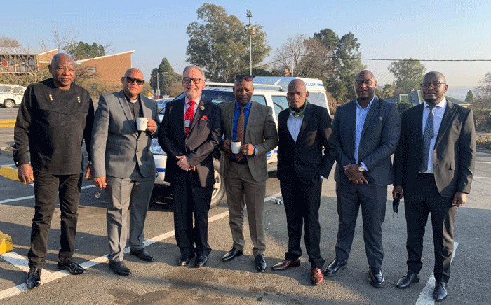 Suspended ANC member Carl Niehaus (third from left) with his legal team and those he referred to as his comrades on 18 August 2021 outside the Estcourt Magistrates Court. Picture: @niehaus_carl/Twitter.