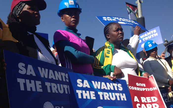 Democratic Alliance members hold placards during a picket at SAFA House on Friday 19 June 2015. Picture: Vumani Mkhize/EWN.