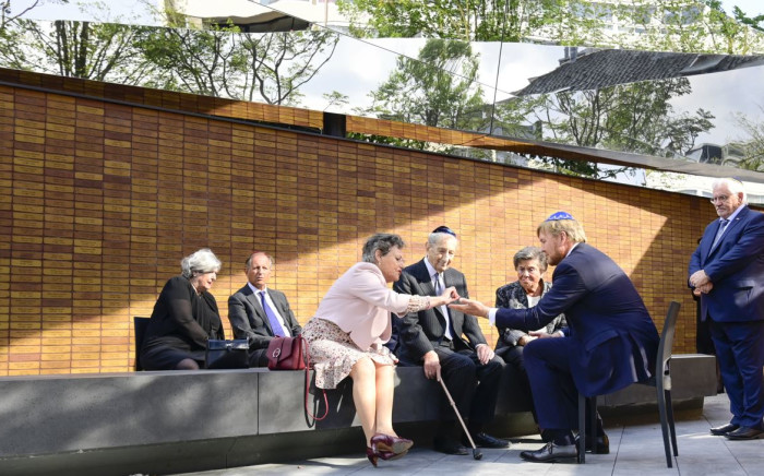 King Willem-Alexander (R) talks with survivors of the Second World War after the unveiling of the Holocaust Memorial of Names in Amsterdam, on September 19, 2021. Picture: AFP.
