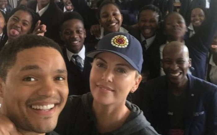 Trevor Noah and Charlize Theron at Oaklands High School. Picture: Supplied.