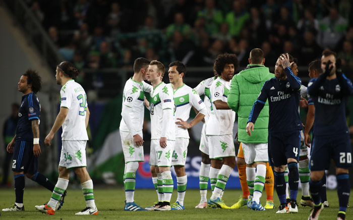 FILE. Players react after the UEFA Champions League quarter-final, first-leg football match between VfL Wolfsburg and Real Madrid on 6 April, 2016 in Wolfsburg, northern Germany. Wolfsburg won the match 2-0. Picture: AFP.