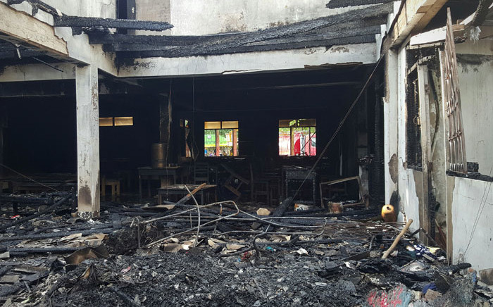 FILE: The burnt remains of a school dormitory are seen in Chiang Rai district in northern Thailand on 23 May 2016. Seventeen girls died after a fire swept through the dormitory of a school for children of hill tribes in northern Thailand, officials said, with a survivor describing fleeing as flames engulfed the building. Picture:  AFPFILE: