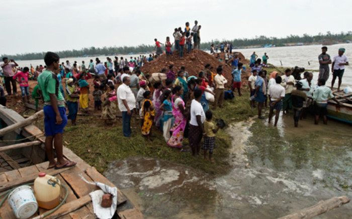 Cyclone Phailin killed at least 18 people, forced one million from their homes and left a trail of destruction along the east Indian coast. Picture: AFP