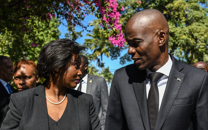 FILE: President of Haiti Jovenel Moise (R) arrives with the first lady Martine Moise (L) for the official ceremony of Haiti's 10th earthquake anniversary in Port-au-Prince, on 12 January 2020. Picture: CHANDAN KHANNA / AFP